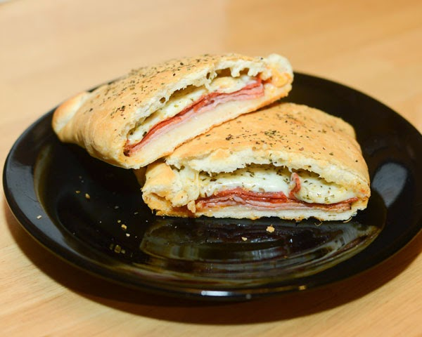The best Stromboli filled with ham pepperoni cheese and spices.