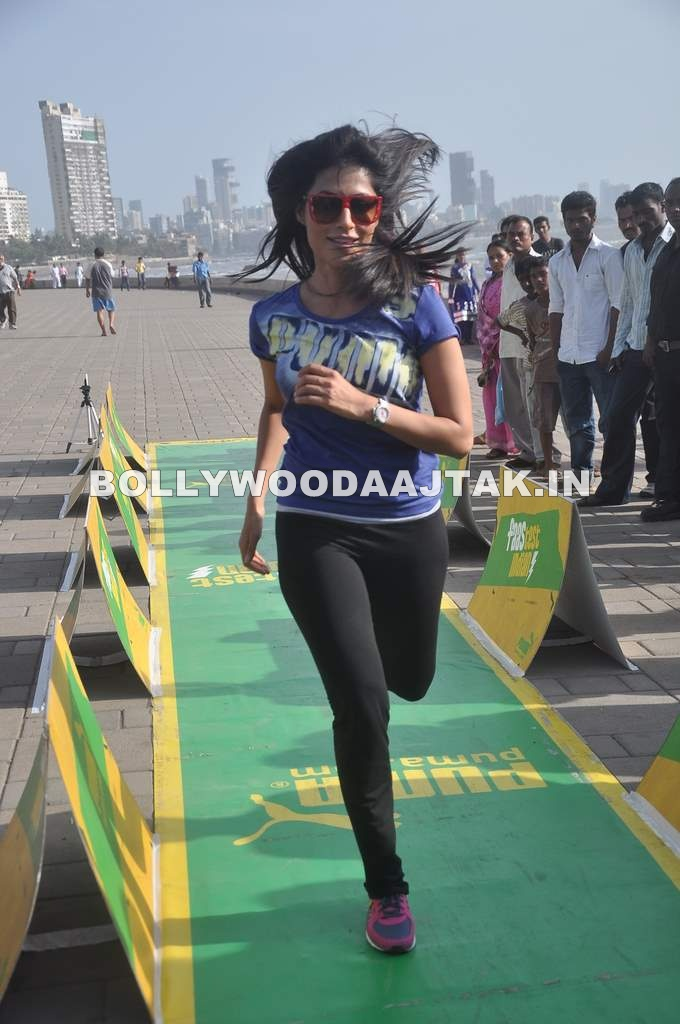 Chitrangda Singh running in tights -  Chitrangda Singh at PUMA promotional event - april 2012