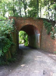 Brick bridge carrying the former Lambourn Valley railway line over Moor Lane, Newbury