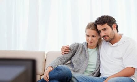 man woman watching TV television - Is TV Romance Bad for Your Relationship?