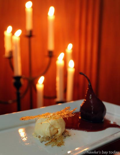 A beautifully poached pear in red wine and spices, vanilla bean icecream and almond praline - dessert at Heavenly Blends and Bites, at The County Hotel, Napier, an event part of the Hawke's Bay F.A.W.C Food and Wine Classic photograph