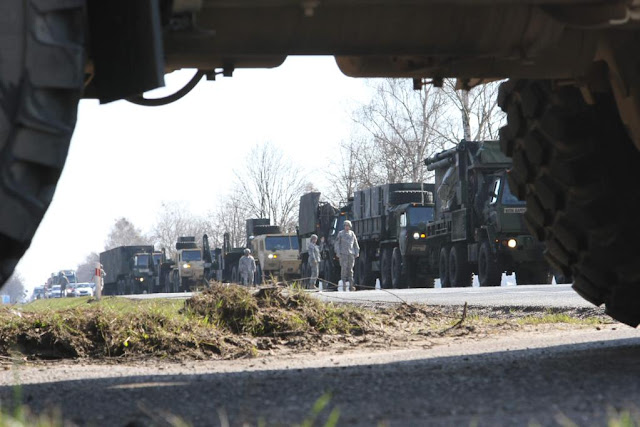 A column of military vehicles carrying a Patriot missile system
