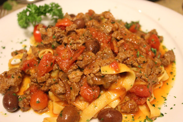Pasta with filet, tomatoes, capers, and olives