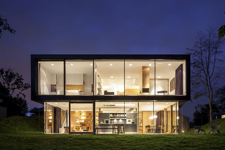 Backyard facade of Modern Villa V by Paul de Ruiter Architects at night