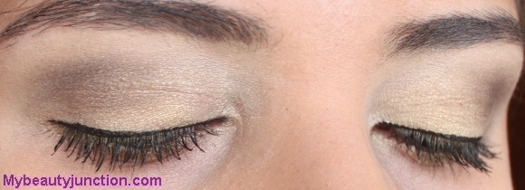 Pale gold eye makeup look with Balm Voyage palette