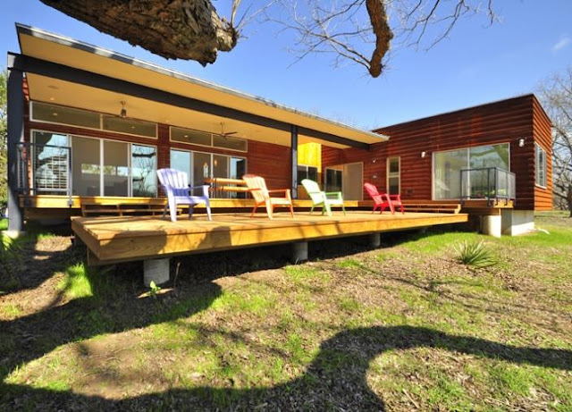 Custom prefab modular house with patinated metal facade for Steel prefab house