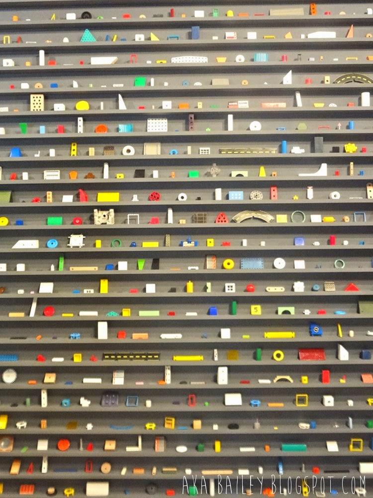 Douglas Coupland art, neatly arranged knick-knacks on shelves
