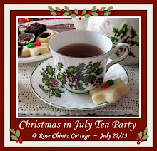 "Click the button to visit my ""Christmas in July"" tea party"