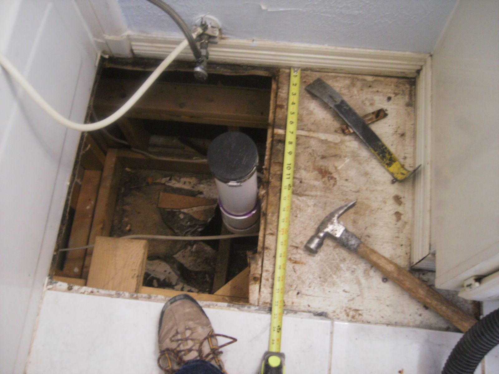 Anatomy of a floor tile repair in photos confessions of a tile this is a common problem we run into with wood floors a toilet flange valve upper bowel or water line gets loose or old and starts leaking dailygadgetfo Choice Image