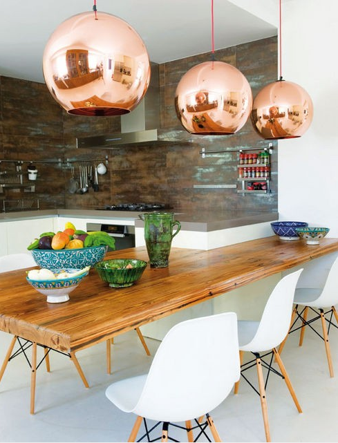 Where the Sidewalk Begins Dining Table Copper Hanging Lights