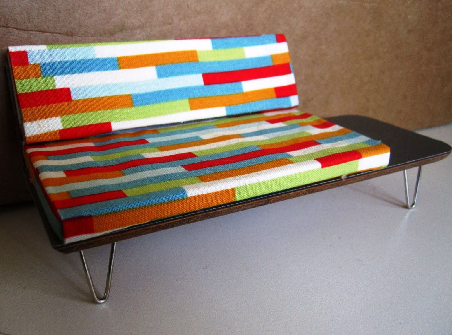 Colourful retro modern miniature sofa created by Mod Pod Miniatures
