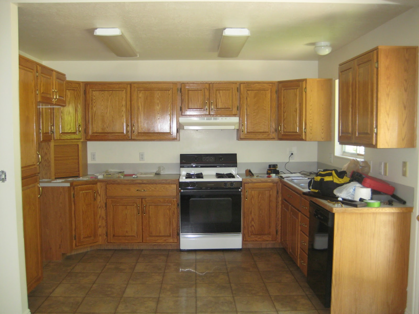 Everywhere beautiful kitchen remodel big results on a for Kitchen remodel oak cabinets