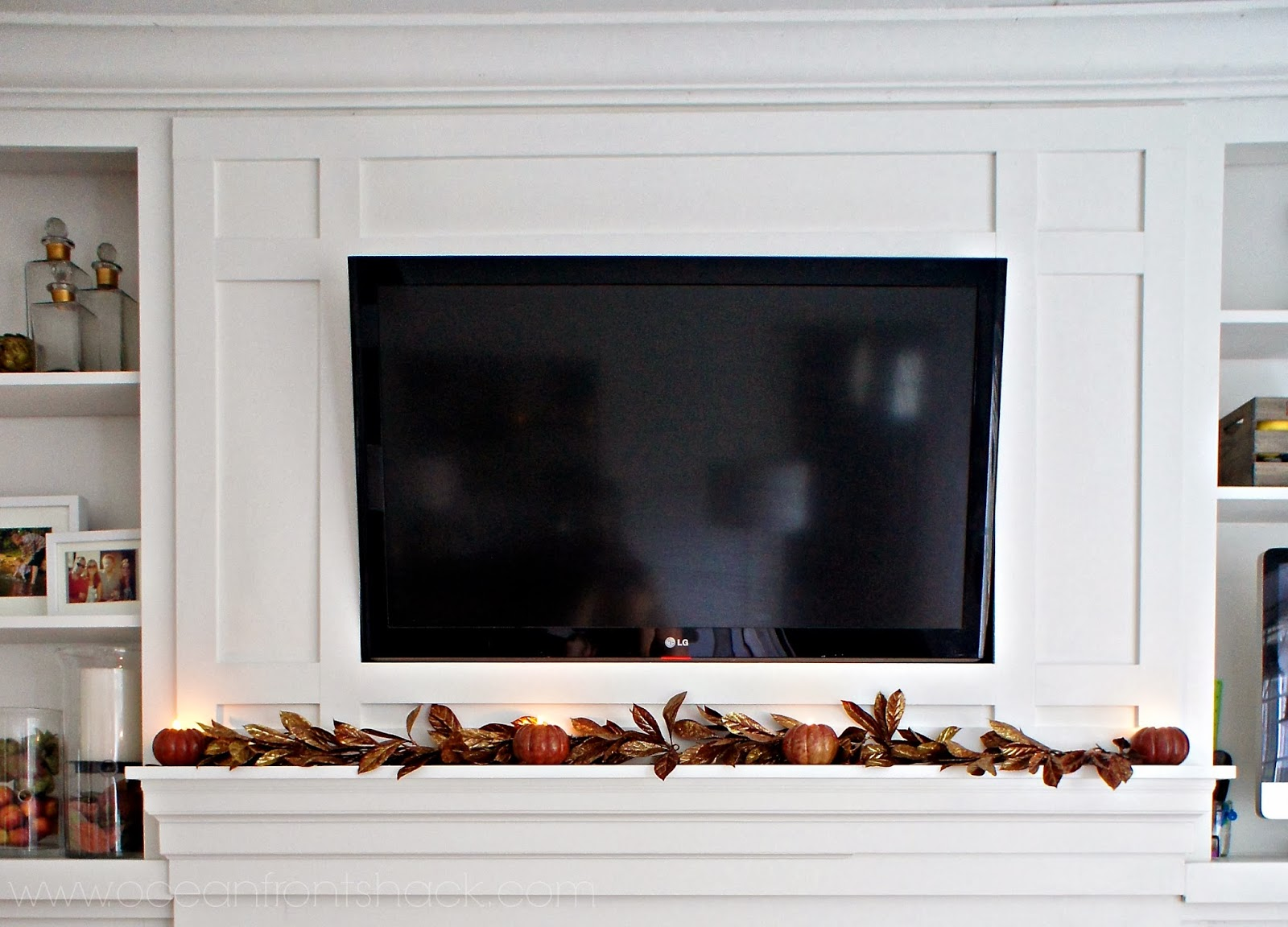 framing in our tv over the fireplace