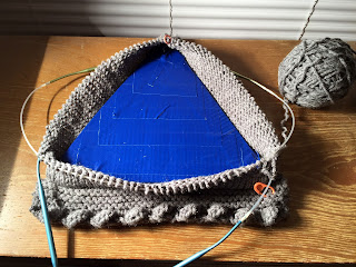 knitted base, cardboard support