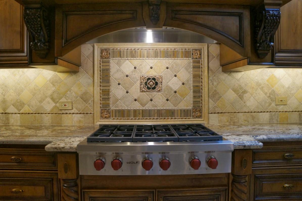 Fleur de lis backsplash tiles - River Bordeaux Granite