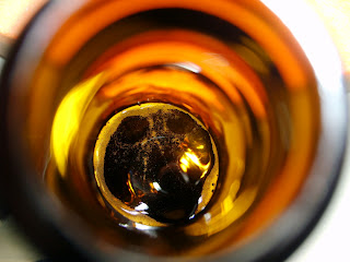 Macro shot, inside of beer bottle