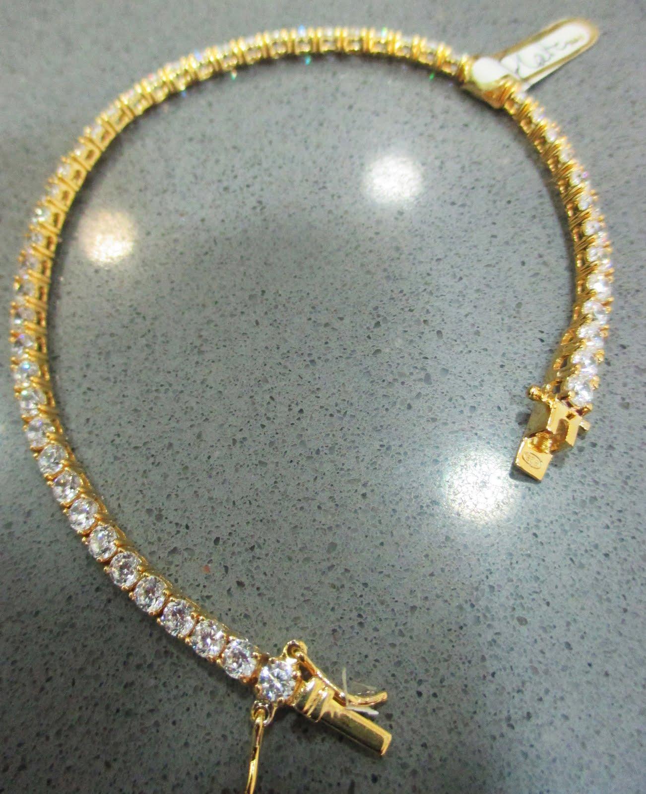 Pulsera de plata dorada con circonitas