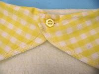 Yellow flower button fastening dribble bib