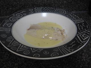Basil steamed tilapia with lemon creme sauce