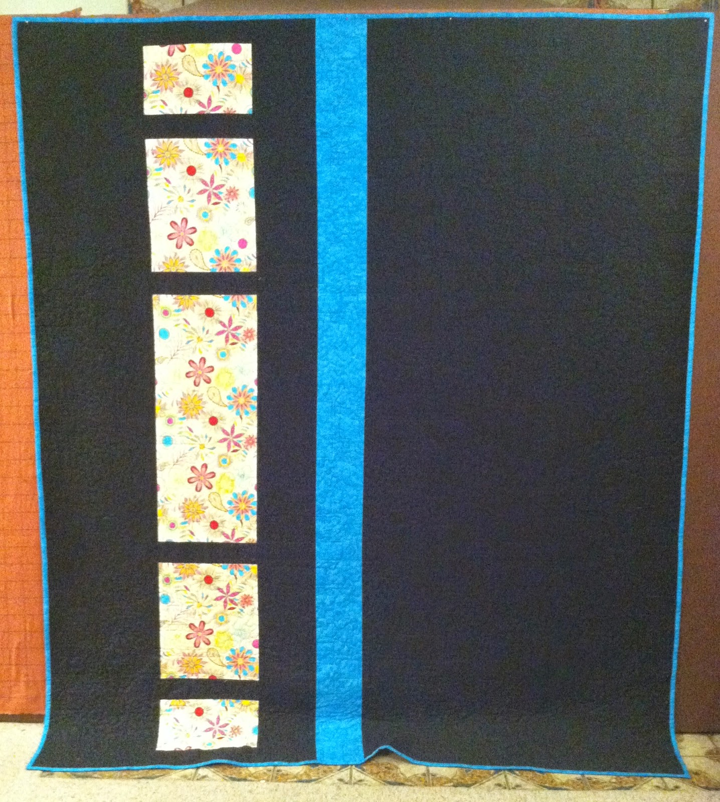Jelly Roll Quilt - Bright colors against a black background is stunning! Reversible too!