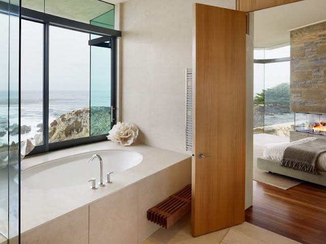 Picture of modern bathtub by the window in the bathroom