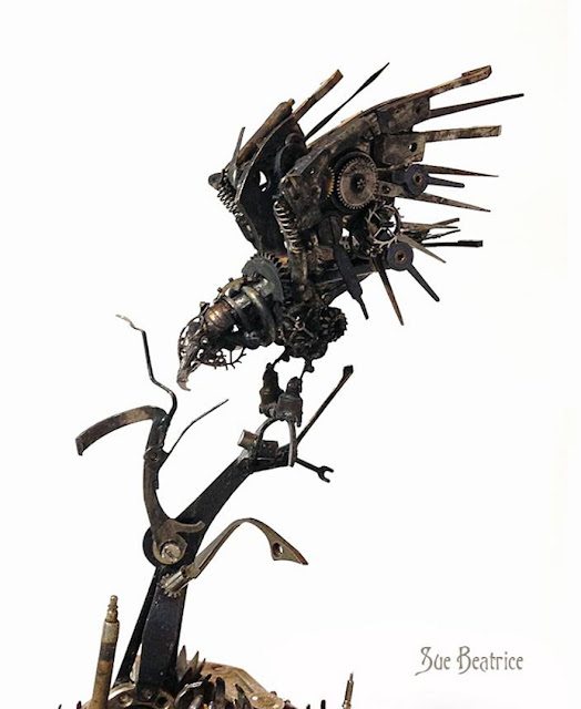 Intricate steampunk sculpture of recycled old parts watch