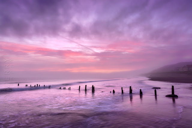 Photograph of beach groynes at sunrise in Sandsend seafront by Martyn Ferry Photography