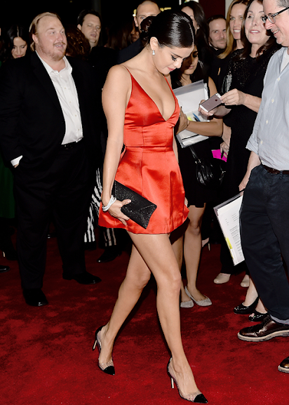 Selena Gomez arrives for the 'Rudderless' LA premiere in a low-cut red mini dress