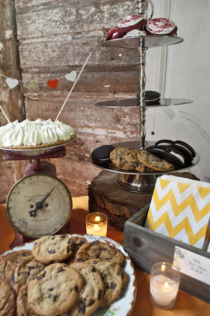 Vintage Rustic Farm Wedding Catskills shot by fine art wedding photographer Angela Cappetta view of room set for dinner in barn dessert table
