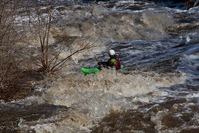 charging past one of the big holes on the Vermillion River, Chris Baer, Minnesota