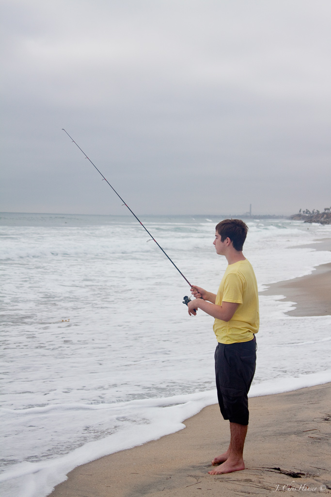 Chris the photog surf casting in the south for Matanzas inlet fishing