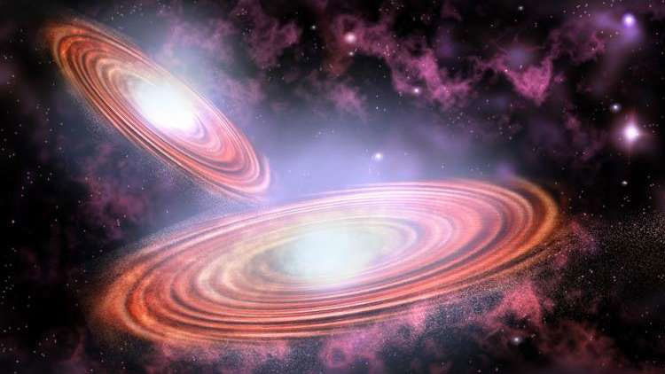 El choque de dos agujeros negros supermasivos generará una potente explosión.