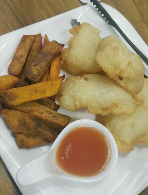 A photo of crispy fish and kamote fries from Kuya J Restaurant