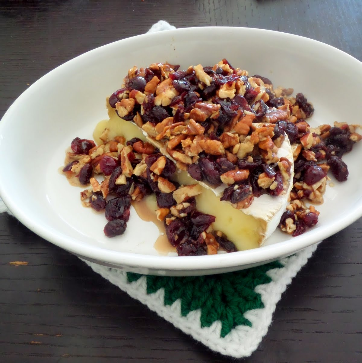 Cranberry Pecan Baked Brie:  A delicious, colorful, and simple holiday appetizer of brie topped with dried cranberries, pecans, and honey.
