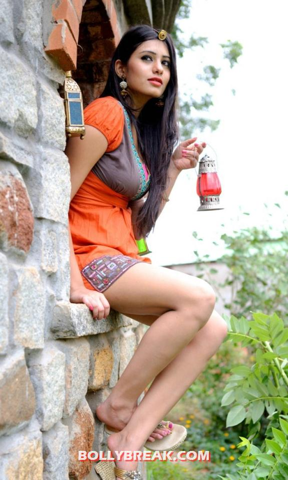Deepa looking as stylish as ever in sahdes of orange -  Deepa Sannidhi HOT photo shoot