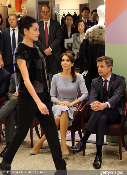 Crown Prince Frederik and Crown Princess Mary watch a seal skin fashion show by Danish designer Jesper Hovring at a department store in Tokyo