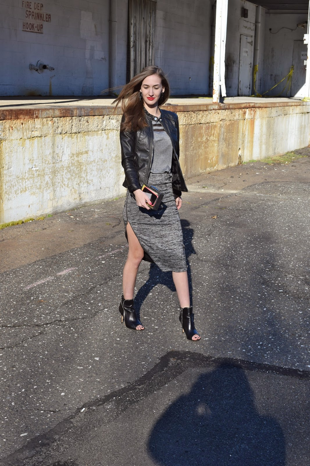 wearing Express faux leather moto jacket, H&M Varsity mesh t-shirt, Express side zip skirt, halogen ankle booties