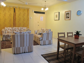 Photo 1: The living and dining area
