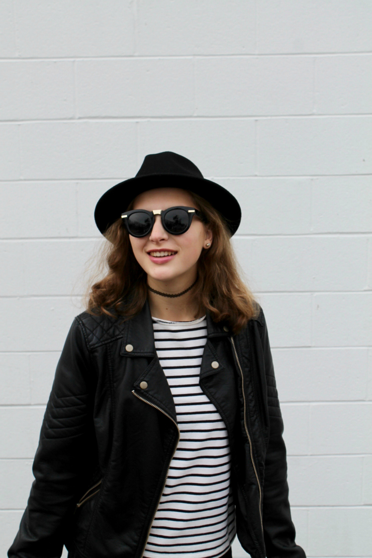 Parisian outfit - striped Breton, black leather jacket, black skinny jeans, black fedora and black leather slip on sneakers