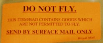 Reads 'Do Not Fly. This bag contains items which are not premitted to fly.'