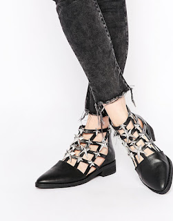 http://www.asos.com/Eeight/Eeight-Nelly-Cut-Out-Star-Embellished-Ankle-Boots/Prod/pgeproduct.aspx?iid=5453258&cid=4172&sh=0&pge=2&pgesize=36&sort=-1&clr=Black&totalstyles=2103&gridsize=3