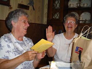 Mom and Aunt Bob enjoying a festive birthday celebration.
