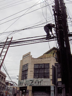 man on ladder middle of street