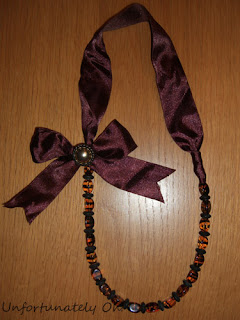beads and bow necklace