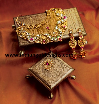 Tbz Jewelry Designs http://www.indiangoldesigns.com/2011/10/tbz-designer-bridal-gold-neckace-set.html