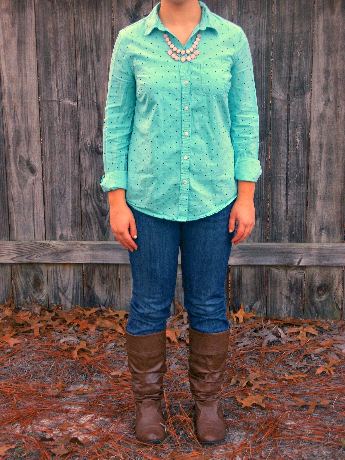 Turquoise and Light Pink. polka dot button down, pink necklace, jeans, brown boots