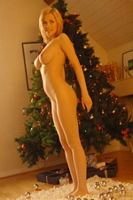 "Busty blonde babe Iga naked & waiting for Santa on Christmas eve! ""Breath Takers"""