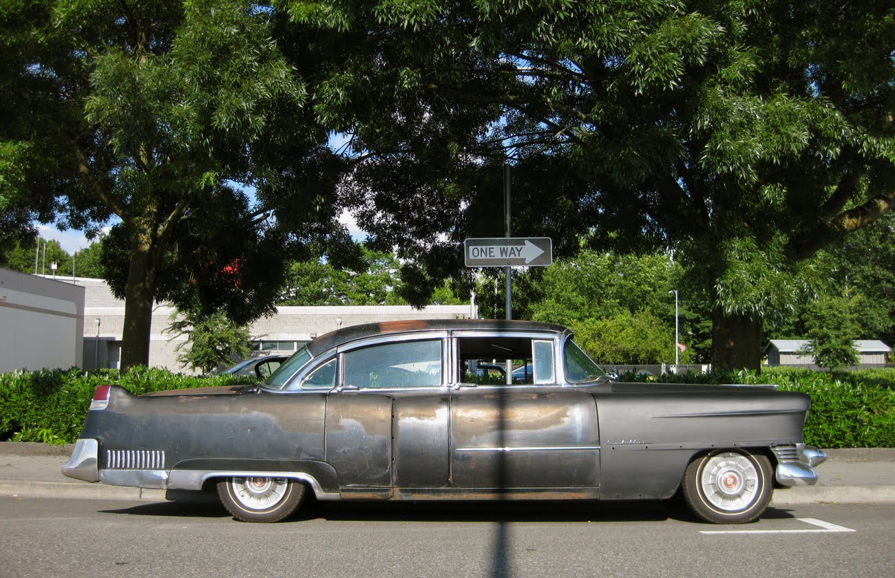 OLD PARKED CARS.: 1954 Cadillac Fleetwood.
