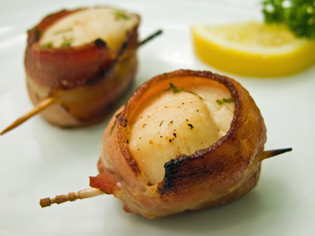 ... marinated sea scallops with the salty crisp bacon. Finger food at one