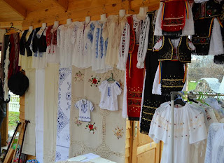 Romanian traditional costumes Stand Near Castle Bran